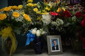 Flowers from Johnathan's funeral on the kitchen table near his senior portrait. Credit Damon Winter/The New York Times
